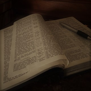 Bible open with pen